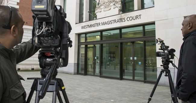 Accused killer of UK lawmaker refuses to state name in court