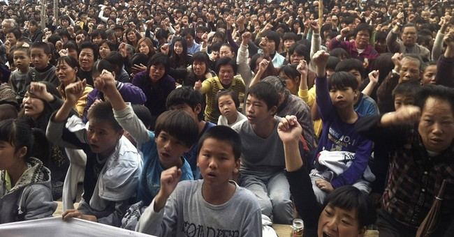 Police lock down Chinese village to ward off protests