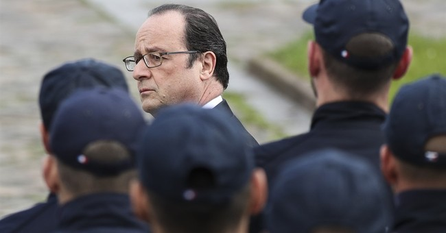 Prosecutor wants 2 charged over French police attack