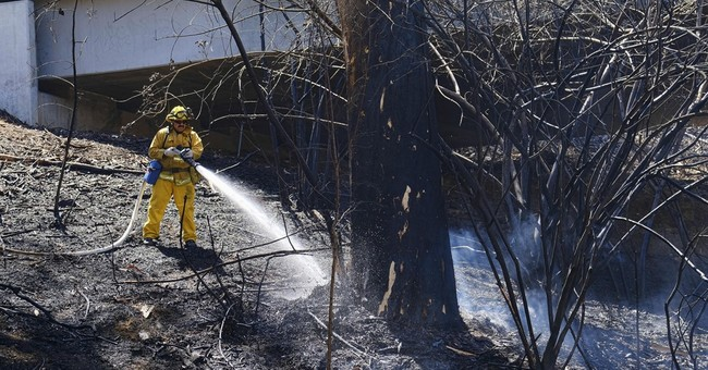 Fire scares Los Angeles as larger blazes burn across West