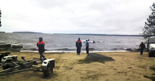 Boats with children overturn in storm in Russia, killing 14