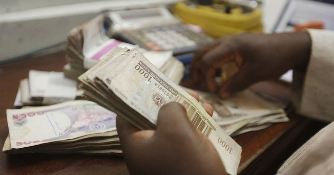 Nigeria's currency plummets as naira floats for 1st time