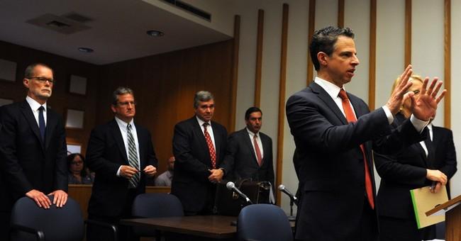 Gun maker asks judge to dismiss lawsuit by Newtown families