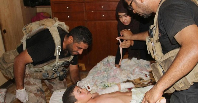 Iraqi forces battle IS in Fallujah days after city's fall