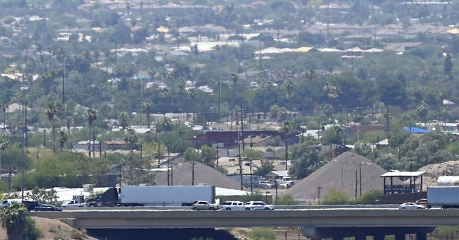 The Latest: 2nd straight record hot day in Las Vegas