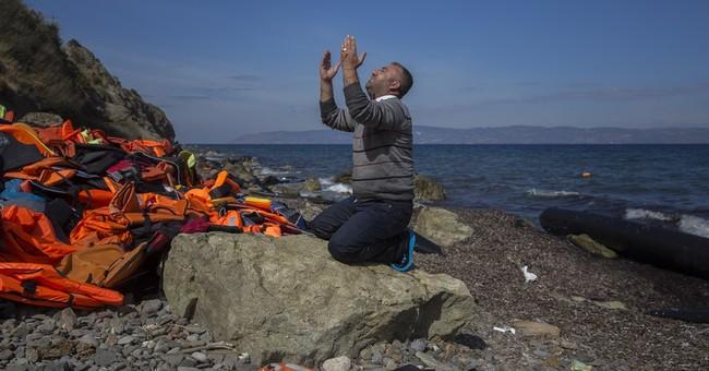 The Latest: Swedish lawmakers tighten asylum rules