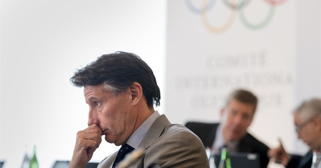 AP Interview: Coe downplays Russian flag issue for Olympics