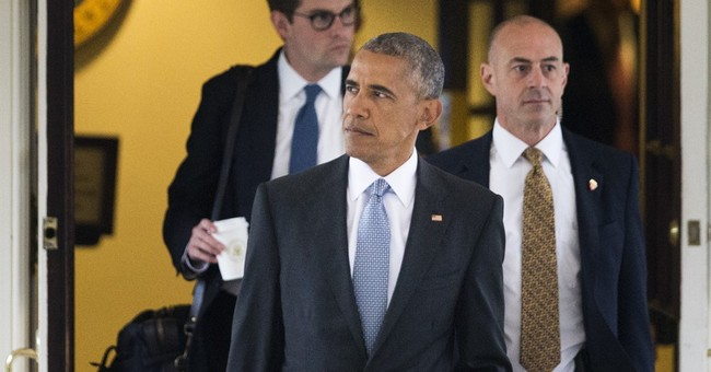 Obama visits a dozen wounded and ill at military hospital