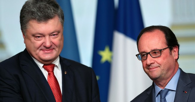 French president floats slow lifting of Russia sanctions