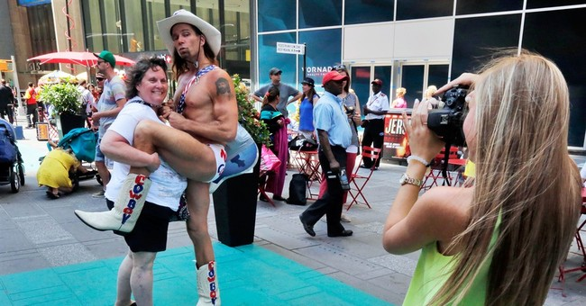 Costumed characters get painted into boxes in Times Square