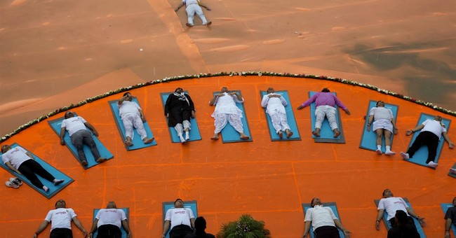 Twist and Om: Millions exercise together for global Yoga Day