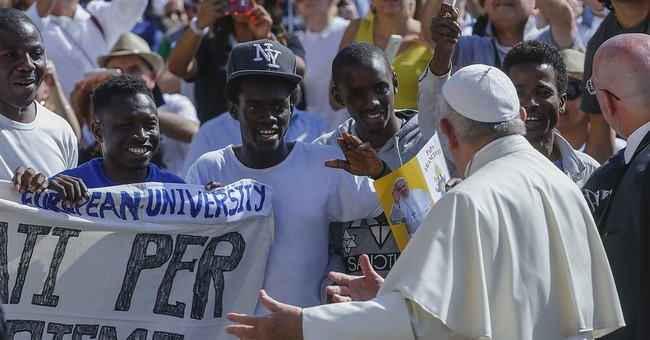 Pope invites refugees to join him on stage for audience