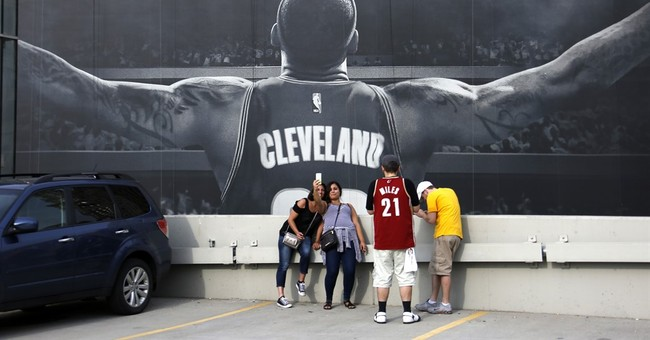 The Latest: LeBron says Cleveland title hasn't sunk in yet