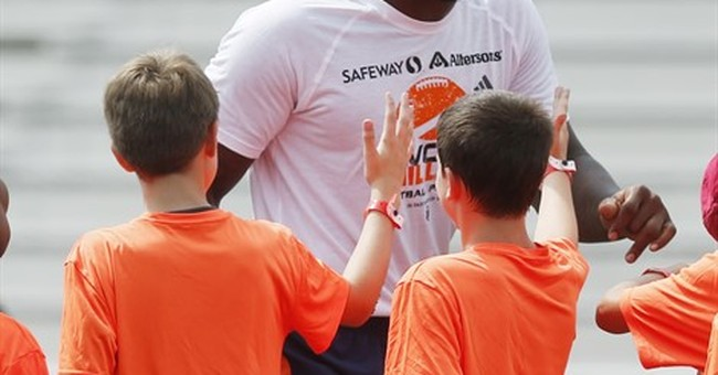 Von Miller gets back on the football field _ at his camp