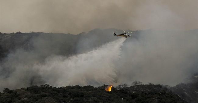 The Latest: Arizona wildfire still threatens communities