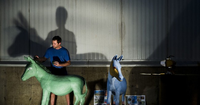 57 donkeys get painted for Democratic National Convention