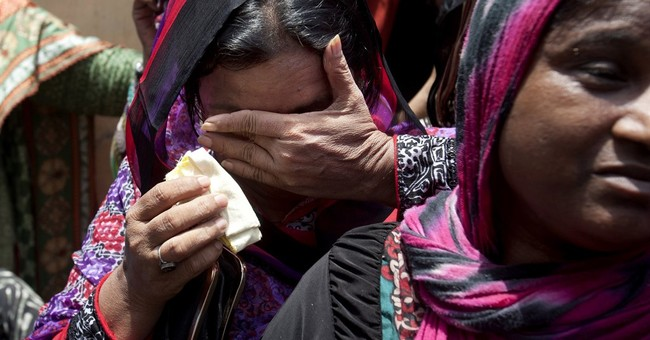 Pakistan holds funeral for Sufi singer slain by militants
