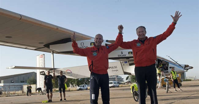 Solar-powered plane lands in Spain