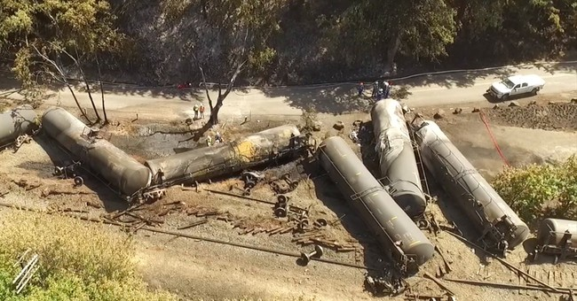 Railroad to replace bolts after fiery oil train derailment