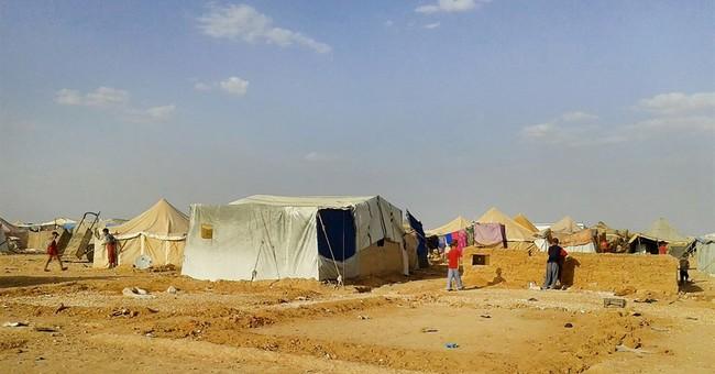 Water trucks head to Syrians stranded on Jordan border