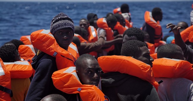 The Latest: New wave of smuggler boats includes 31 dinghies