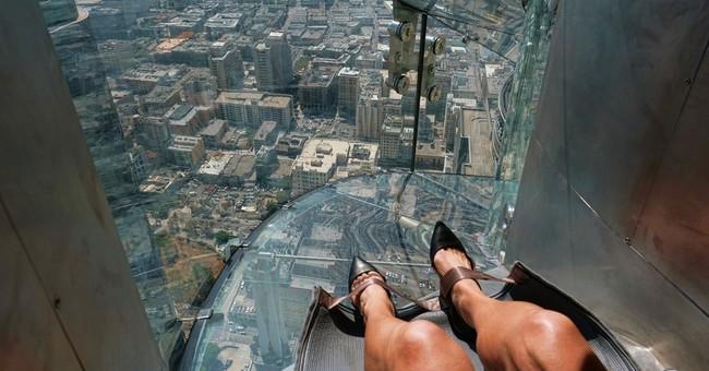 AP reporter's terrifying trip on 1,000-foot-high glass slide