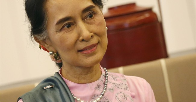 Suu Kyi tackles migrant workers' plight during Thailand trip