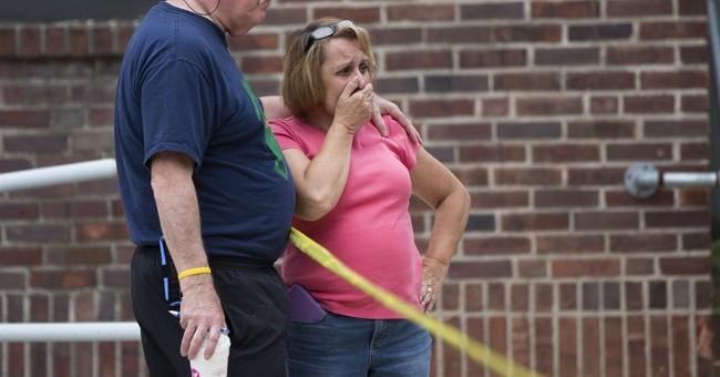 The Latest: Suspect on parole in gun case when cop shot