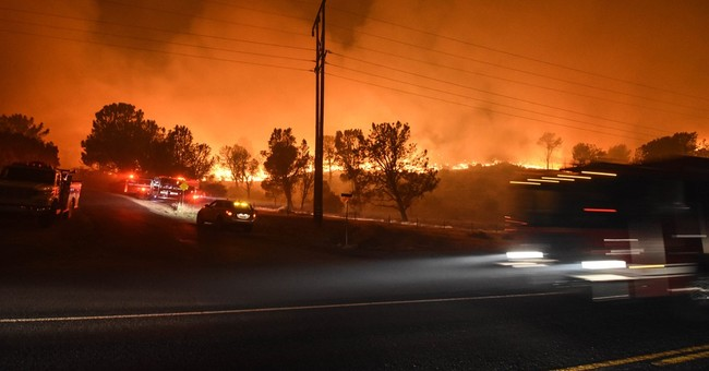 The Latest: Forest Service chief tours damage in New Mexico