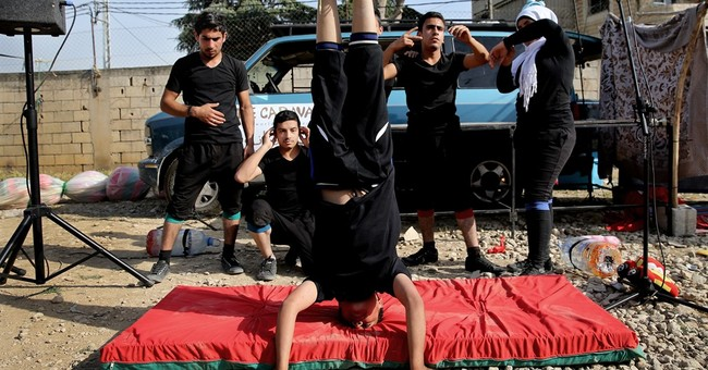 Street performance by Syrians in Lebanon opens wounds