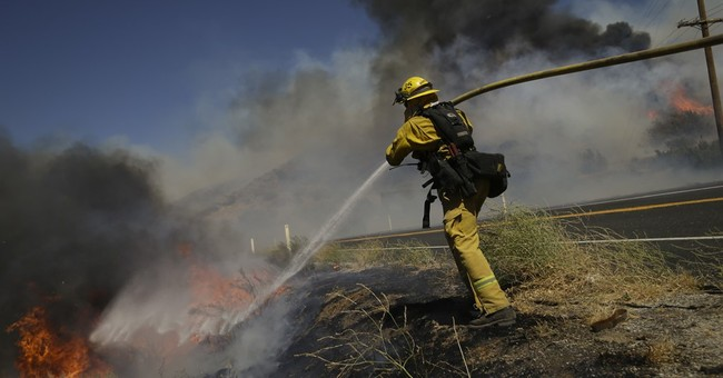 The Latest: Possible human remains found in wildfire