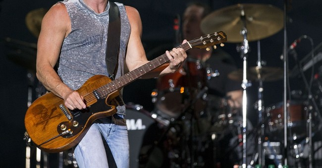 Kenny Chesney calls cop to apologize for saying he had died