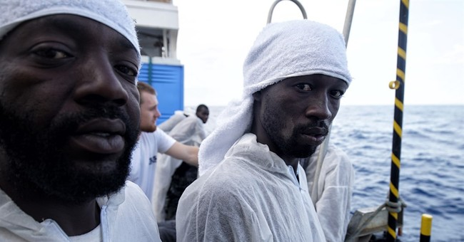 The Latest: Greek police arrest 5 for migrant smuggling