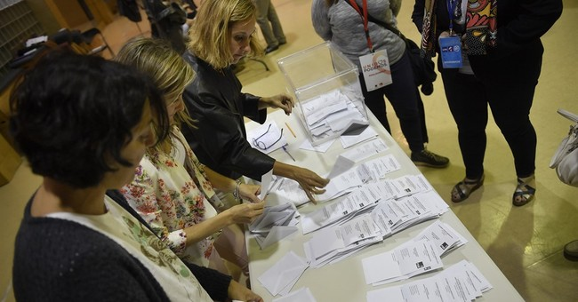 The Latest: Rajoy demands 'right to govern' after election
