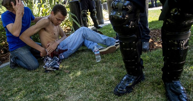 The Latest: 10 hospitalized in clash at California capitol