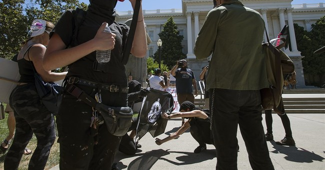 10 stabbed, beaten at white nationalist rally in California