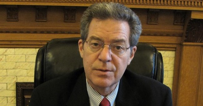 Governor signs bill aimed at keeping Kansas schools open