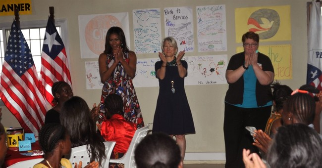 Michelle Obama, daughters in Africa to push girls' education