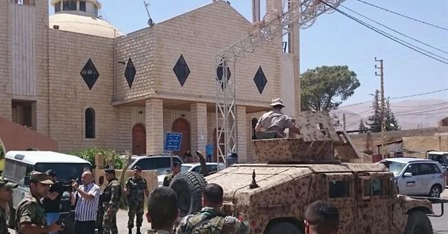 Suicide bombers kill 5 in eastern Lebanon, near Syria border