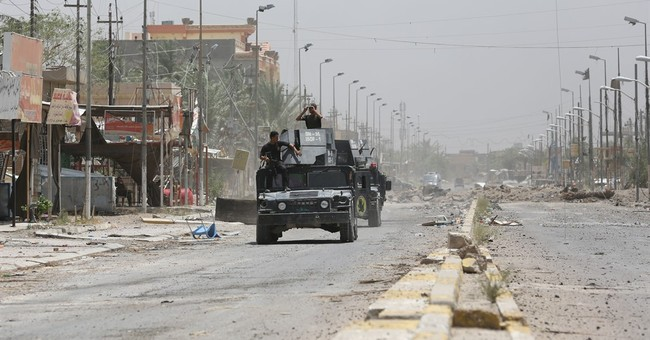 Homes burned, looted in Iraqi city after defeat of militants