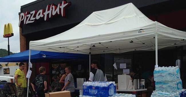 In rain-soaked West Virginia, flood victim planning funerals