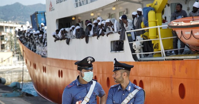 The Latest: Italy recovers 6 bodies from 2015 migrant wreck