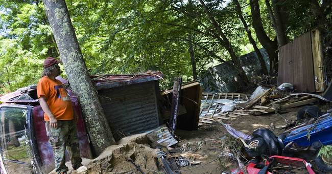 The Latest: Governor: Thousands of homes, businesses damaged