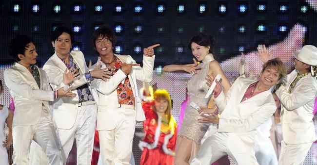 Japanese pop group SMAP denies rumors it will split