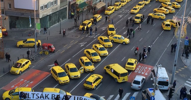 Taxis in Budapest block traffic, demand ban on Uber