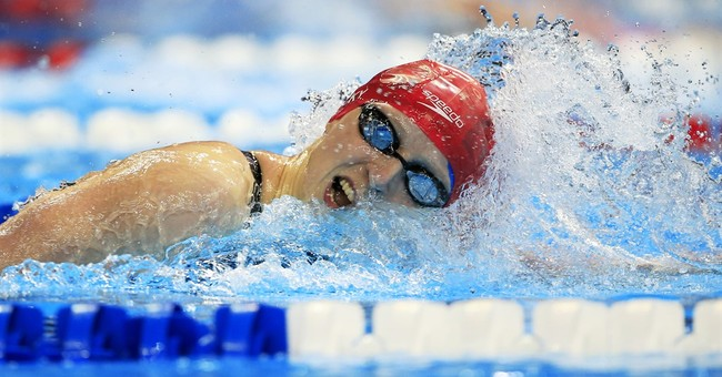 Phelps, Ledecky cruise into semis at US Olympic swim trials