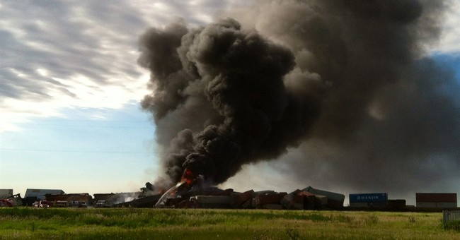 The Latest: Fire still burning at site of Texas train crash