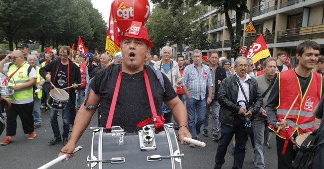French workers protest in Paris; Senate passes labor reforms