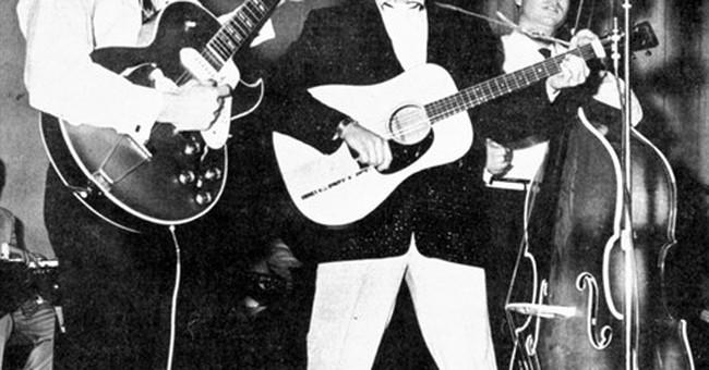 Scotty Moore, Elvis Presley's first guitarist, dies at 84