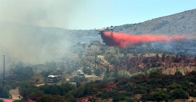 The Latest: Navajo Nation crew deployed fire shelters